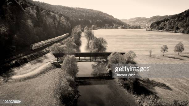 commuter train covered bridge river neckar