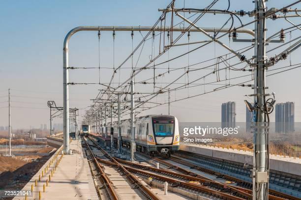 train and railroad tracks in zhengzhou, henan, china - 鄭州市 ストックフォトと画像