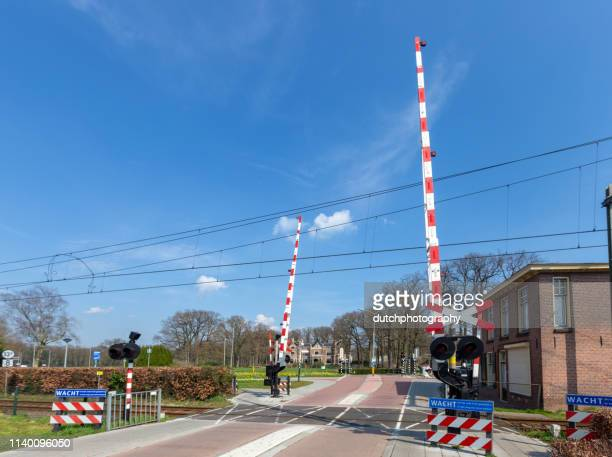 Train and railway crossing in Barneveld Center, the Netherlands