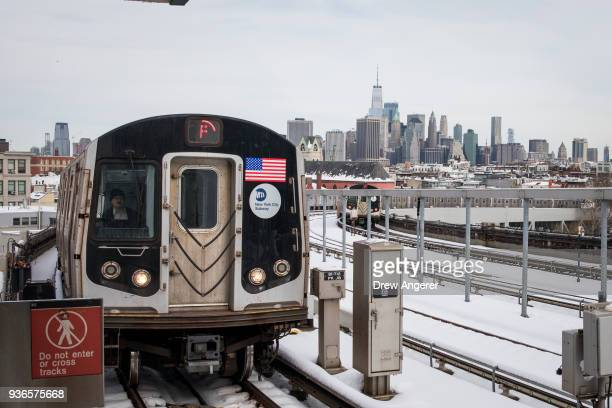 A train approaches the station at the SmithNinth Street station March 22 2018 in the Brooklyn borough of New York City According to a report by...