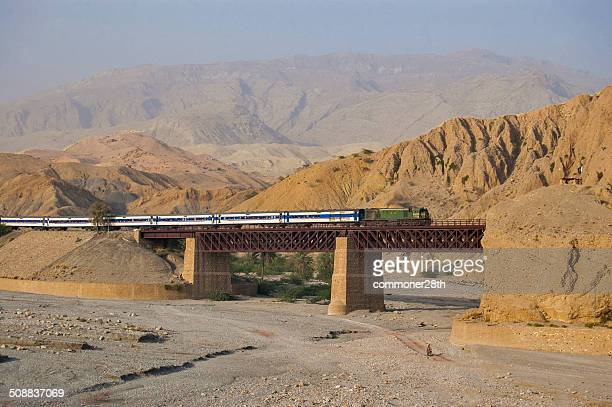 train approaching a bridge in bolan pass. - quetta stock pictures, royalty-free photos & images