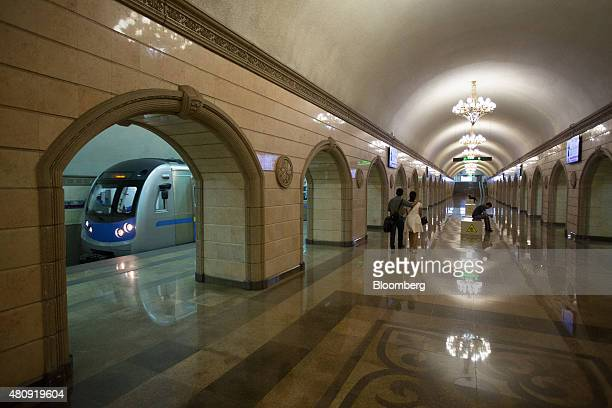 A train arrives at a platform at the Mukhtar Auezov theater metro station in Almaty Kazakhstan on Saturday June 27 2015 Almaty with a population of...