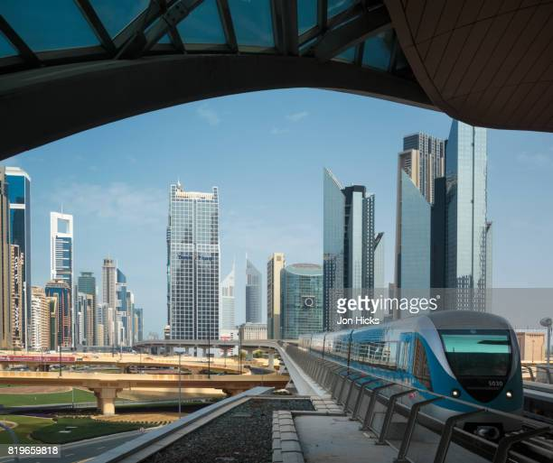 train arriving at a downtown station on the dubai metro. - underground station stock pictures, royalty-free photos & images