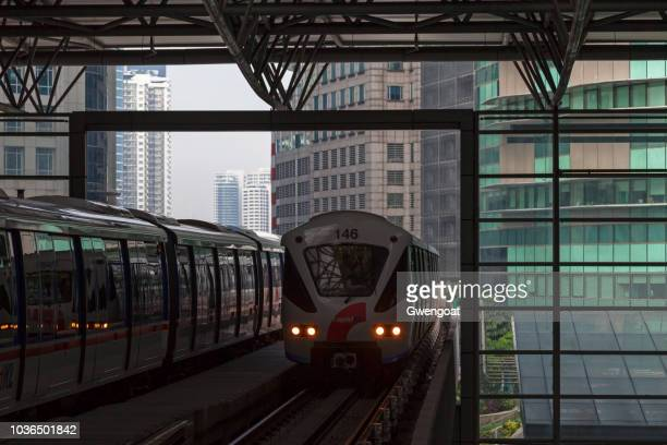 lrt train arriving at kl sentral - gwengoat stock pictures, royalty-free photos & images