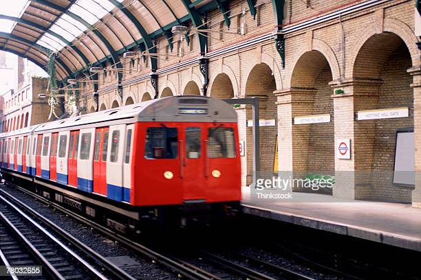 A train arriving at Notting Hill Gate in the Underground of London, England.