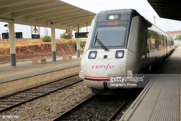 Train arriving at platform of railway station, Caceres, Extremadura, Spain.