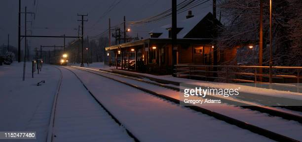 a train arriving at the station on a snowy evening - montgomery county pennsylvania stock pictures, royalty-free photos & images