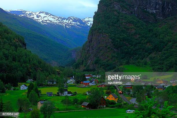 Train arriving in Flam norwegian village evening from above, Norway