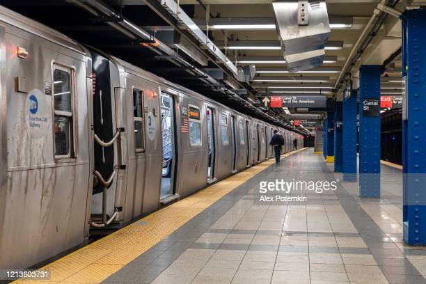train arriving to the platform of canal street subway station deserted because of covid-19 coronavirus outbreak. - alex potemkin coronavirus stock pictures, royalty-free photos & images