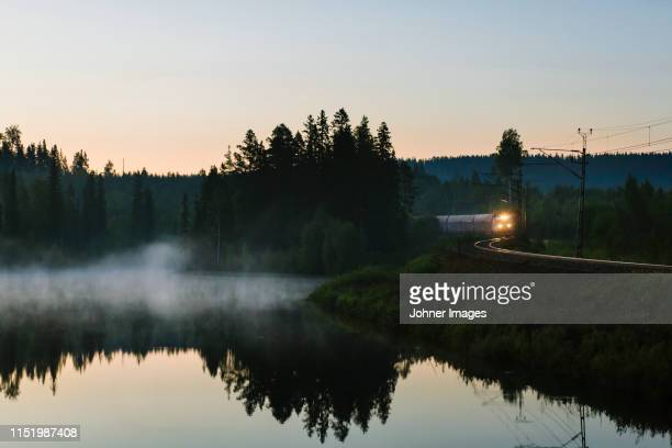 train at lake - sweden stock pictures, royalty-free photos & images