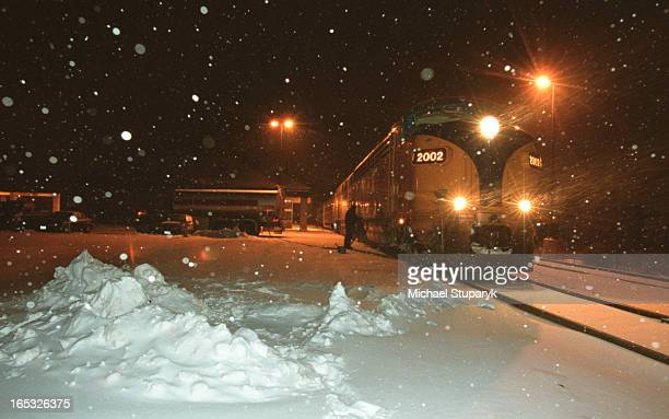 Train at North Bay late at coming up from Toronto on Monday nightlots of snow and coldfellow is refueling the train Father and son Peter Cappadocia32...