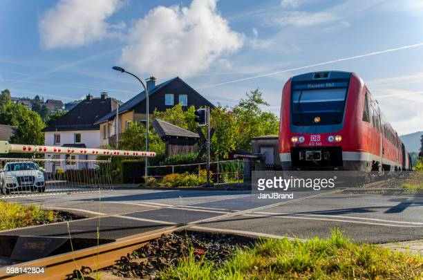 train at railroad crossing in messinghausen, germany - railroad crossing stock pictures, royalty-free photos & images