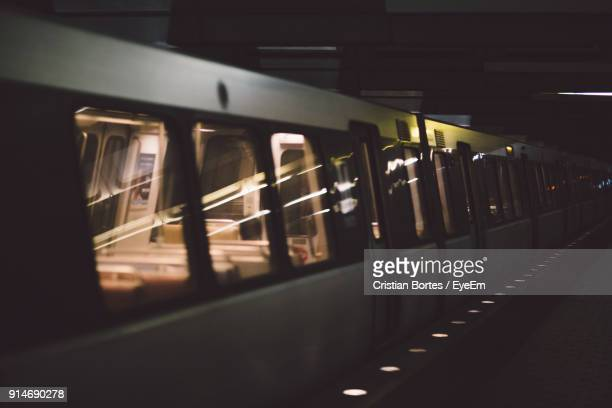 train at railroad station platform at night - bortes stock pictures, royalty-free photos & images