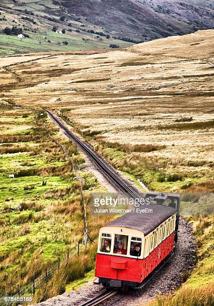 train at snowdonia national park - snowdonia stock photos and pictures