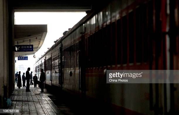 A train attendant monitors a departing train at the Wenzhou Railway Station on January 23 2011 in Wenzhou of the Zhejiang Province China According to...