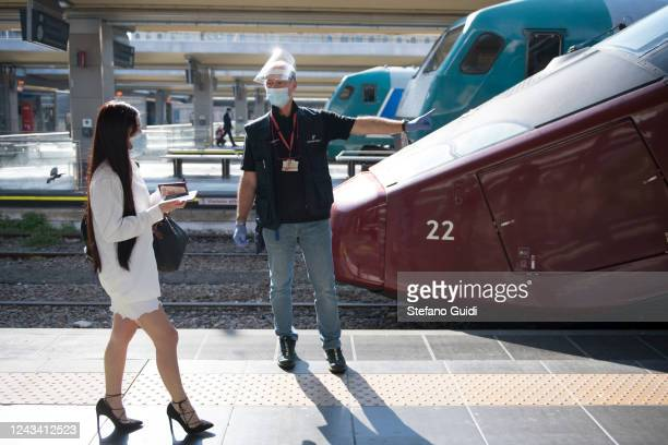 A train attendant wearing a protective masks gives directions to a traveler at the Porta Nuova railway station on June 03 2020 in Turin Italy Today 3...