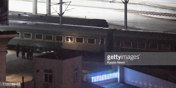 A train believed to be carrying North Korean leader Kim Jong Un leaves Dandong Station in the Chinese border city with North Korea on Feb 23 as he...