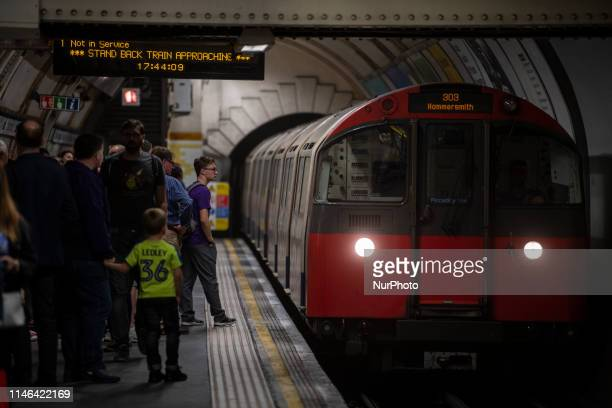 A Train belonging to London Underground pulling into a Tube Station in London United Kingdom 26 May 2019