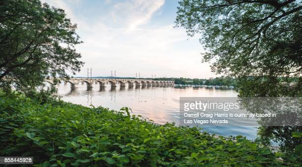 train bridge over the susquehanna river in harrisburg pennsylvania - harrisburg pennsylvania stock pictures, royalty-free photos & images