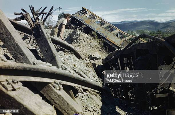 Train Busting In The Cortonaarezzo Area Italy July 1944 A British soldier inspecting a goods train destroyed in raids by the Allied Air Forces on the...
