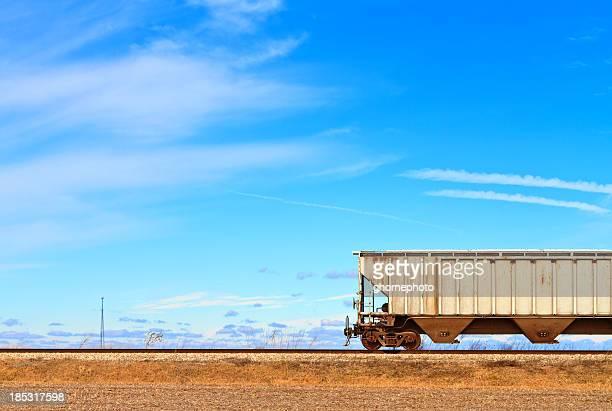 Train car on railroad tracks