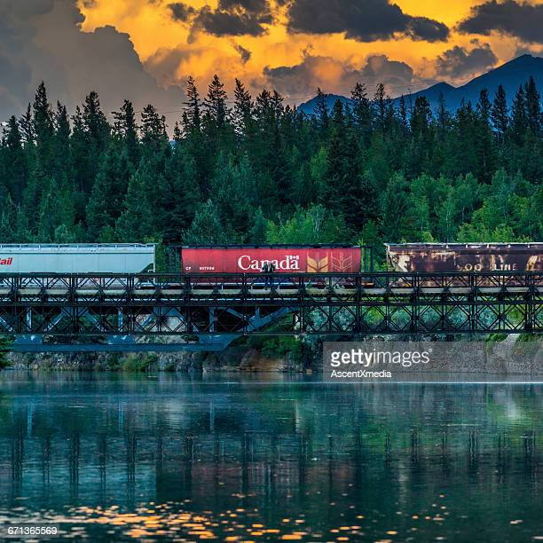 train cars pass over trestle bridge, mountains - rail transportation stock pictures, royalty-free photos & images