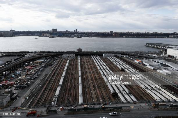 Train cars sit in the West Side Yard on the West Side of Midtown Manhattan in New York United States on March 18 2019 The elaborate honeycomblike...