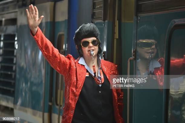 A train conductor dressed as Elvis signals for the train to leave Central station to take people to the Parkes Elvis Festival in Sydney on January 11...