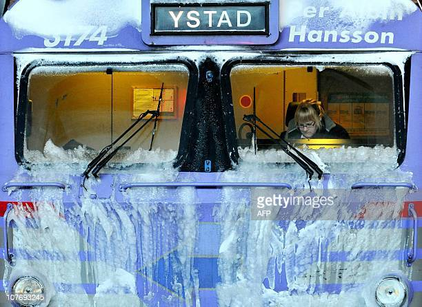 A train conductor sits in her parked locomotive in the central railway station of Malmo on December 20 2010 as hundreds of commuter trains were...