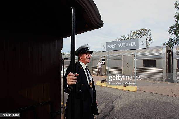A train conductor welcomes passengers of The Ghan aboard the Pichi Richi steam train on April 26 2014 in Port Augusta Australia The Ghan commemorates...