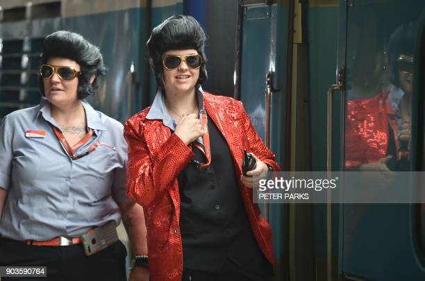 Train conductors dressed as Elvis wait for the train to leave Central station to take people to the Parkes Elvis Festival in Sydney on January 11...