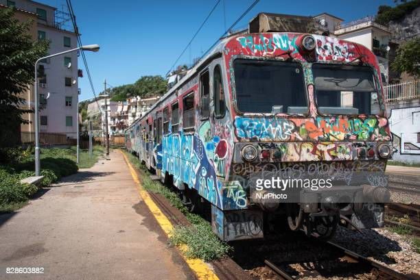 A train covered with graffiti stops at the Gerolomini station in Pozzuoli italy on 23 August 2015