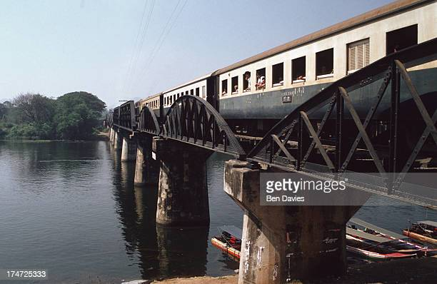 Train crosses the infamous Bridge Over the River Kwai in Central Thailand. During the 2nd world war, countless prisoners of war were put to work on...