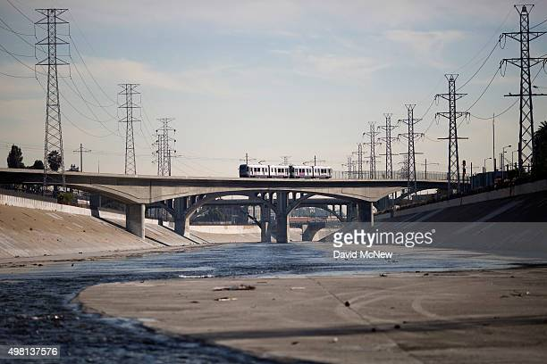 A train crosses the Los Angeles River on November 20 2015 in Los Angeles California With the approach of devastating winter storm conditions due to...