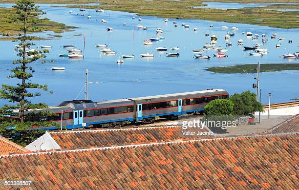 train crossing faro city - faro city portugal stock photos and pictures