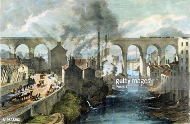 Train crossing Stockport viaduct on London North Western Railway Note pollution of river banks smoking chimneys and complete domination of scene by...
