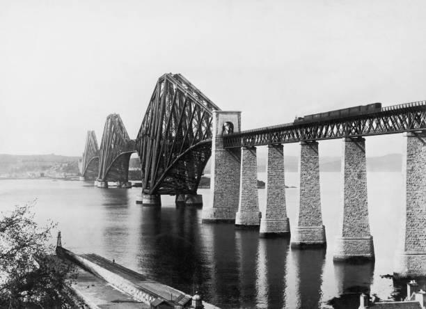 A train crossing the Forth Railway Bridge running across...