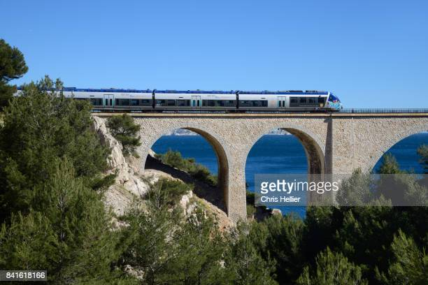train crossing the niolon viaduct near marseille - marseille stock pictures, royalty-free photos & images