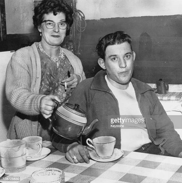 Train driver David Whitby gets a cup of tea from his mother at home in Crewe Cheshire 18th August 1963 Whitby was codriver of the mail train which...