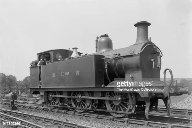 A train driver on Midland Railway Number 2460 Belpaire Firebox locomotive 2441 Class introduced by Samuel Johnson in 1899 England circa 1900