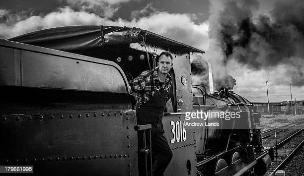 CONTENT] Train driver surveys the platform as the 3016 steam locomotive pulls out the of the station Kingston Canberra