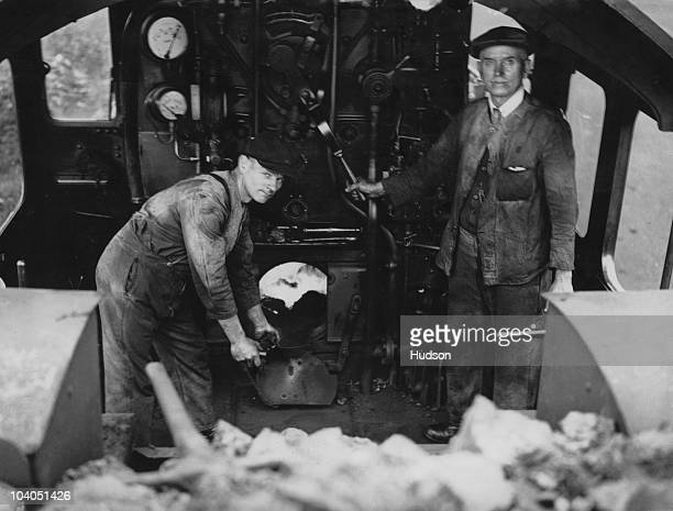 Train driver Tom Lewis and fireman Jarvis on the footplate of GWR locomotive 5016 the Montgomery Castle 9th September 1932 They are hauling the...