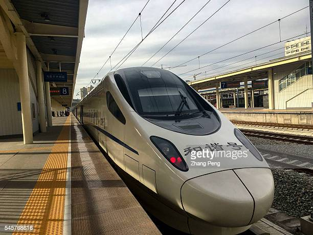 CRH train drives into Urumqi south railway station The LanzhouXinjiang HighSpeed Railway also known as Lanxin Railway a highspeed rail in...