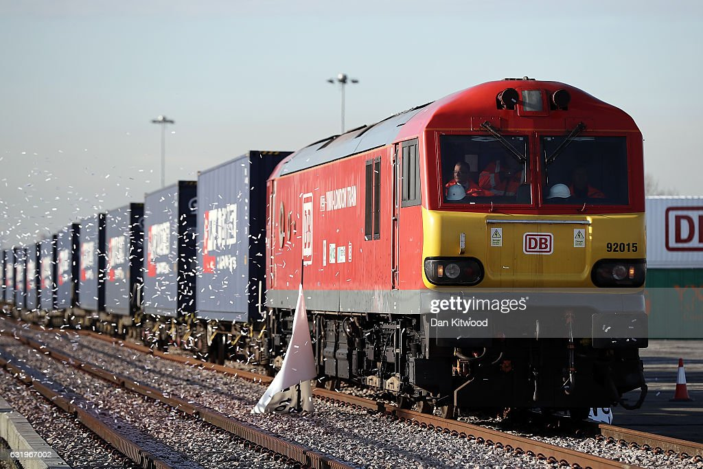 A train engine pulls carriages that started their Journey in Yiwu in China into Barking rail freight terminal on January 18, 2017 in Barking, England. After travelling for 16 days and covering around 7,456 miles passing through China, Kazakhstan, Russia, Belarus, Poland, Germany, Belgium and France, The East Wind freight train which is made up of 34 wagons is hoped will herald a 'new era of UK-China relations'. The Engine that started the journey was changed to accomodate different gauge tracks in the UK.