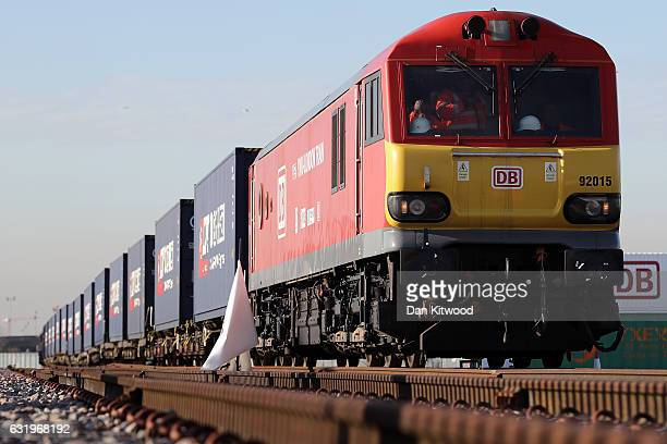 A train engine pulls carriages that started their Journey in Yiwu in China into Barking rail freight terminal on January 18 2017 in Barking England...