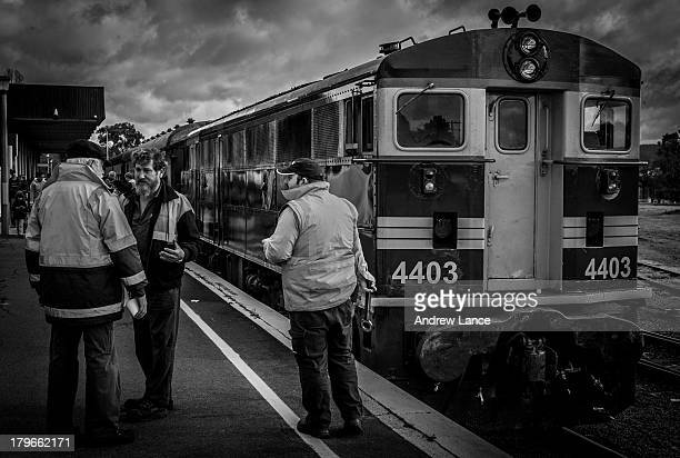 CONTENT] Train engineers and enthusiasts talke and drink coffee in front of the 4403 Diesel Locomotive at the Canberra railway station