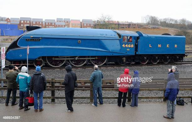 Train enthusiasts look on as the world record breaking Class 4 locomotive 'Mallard' is shunted into position at the National Railway Museum on...