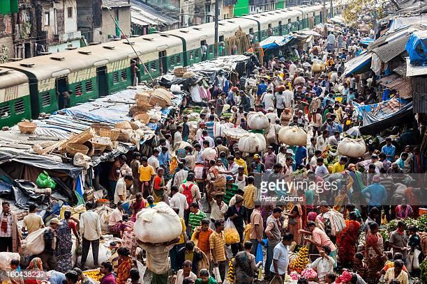 train & flower market, kolkata, india - kolkata stock pictures, royalty-free photos & images