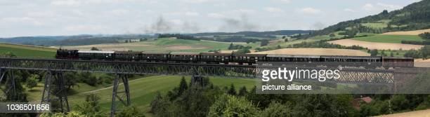 A train from the Sauschwaenzlebahn rides over a viaduct near Blumberg Germany 16 July 2016 The SWR television serial 'EisenbahnRomantik' turns 25...