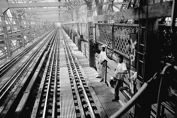 M train going over Williamsburg Bridge from Brooklyn into Ma